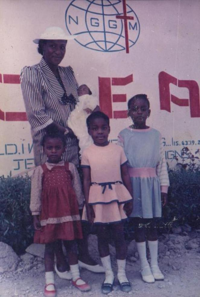 New Generation Bible Church. It was New Generation Gospel Ministries then. Adaora in blue, me in yellow, Chichi in red, Uju the baby. See my soldier man stance?